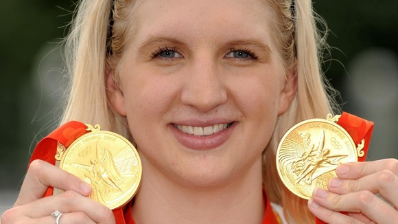Rebecca Adlington showing off the two gold medals she won in Beijing