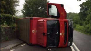 Saltash firecrews have responded to an overturned Royal Mail lorry