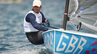 Ben Ainslie practices in his Finn dinghy on Weymouth Bay