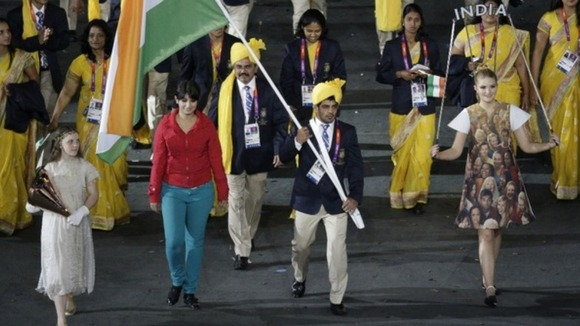 India's flag bearer Sushil Kumar and the unknown woman in red parade at the Olympic opening ceremony