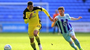 Matthew Briggs (in yellow) in action for Colchester United last season.