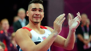 Great Britain's Louis Smith shows emotion after completing his Pommel Horse routine during the Artistic Gymnastics team qualification