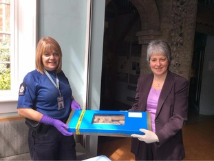 CSI Hilary Miller hands over the remains to Carolyn Wingfield from  Saffron Walden Museum