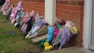 Flowers left at the scene of the fatal fire