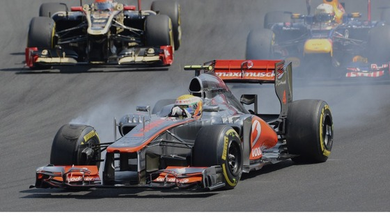 Lewis Hamilton breaks while leading the race after the start of the Hungarian Formula One Grand Prix