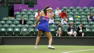 Poland's Agnieszka Radwanska plays in front of empty seats at Wimbledon