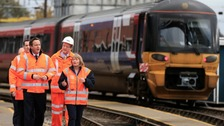 Chancellor George Osborne and Prime Minister David Cameron with Depot Manager Linda Wain and Engineering Director of East Midlands Trains Tim Sayer (second right)