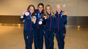 Great Britain Paralympic medal winners Jade Etherington (left) and her guide Caroline Powell (second left) with Charlotte Evans (second from right) and Kelly Gallagher arrive back at Heathrow Airport,