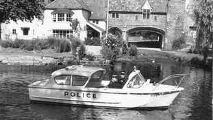 Police officers patrolling the River Wensum in the centre of Norwich.