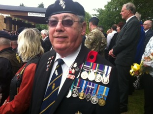 This former soldier attended to pay his respects decorated in his medals