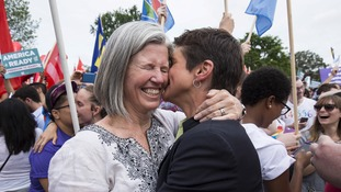 Margaret Conway is kissed by her wife Rea Carey as the news is heard.