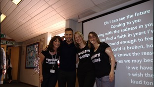 Gary with staff at Lobley Hill Primary.