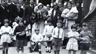 Gladys Tapper can be seen in the front right of the photo in a print dress