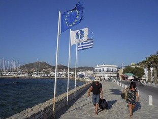 Tourists on the seaside of the island of Paros