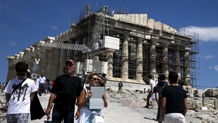 People visit the Parthenon in Athens