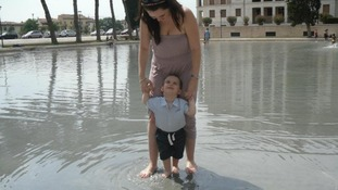 Playing in the fountain with mum