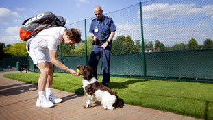 Andy Murray, police dog Ike and Police Sergeant Paul Gibb