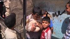 Boys in Aleppo collect bread.