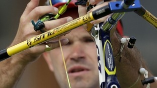 Alan Wills prepares to shoot during the elimination stage at the 2012 Summer Olympics, Saturday