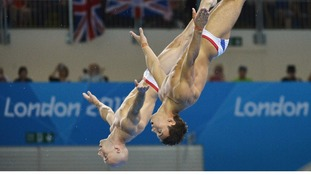 Peter Waterfield and Tom Daley dive in the men's 10m synchronised dive final
