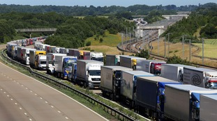 Lorries parked on the M20 near Charing in Kent.