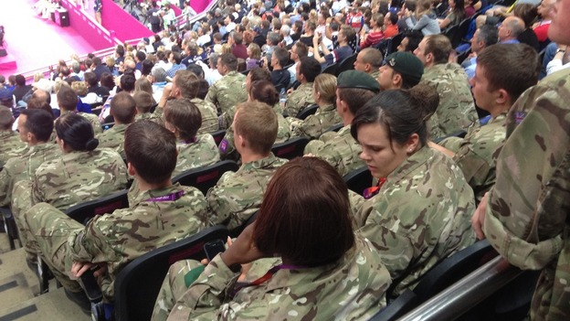 After: Empty seats at the men's gymnastics final filled by military personnel