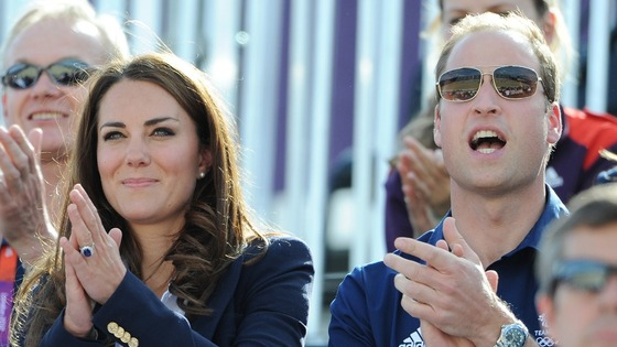 The Duke and Duchess of Cambridge cheer Zara Phillips as she enters the Arena during the Cross Country Phase of The Eventing.