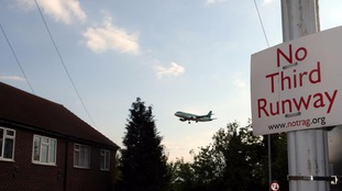 a 'no third runway' signs in the village of Sipson near Heathrow Airport.