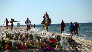 Tributes are left for the victims of the Tunisian beach attack