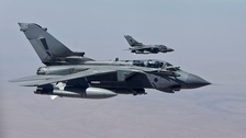 Michael Fallon said it was 'illogical' UK planes were able to hit extremists in Iraq but not bases across the border.