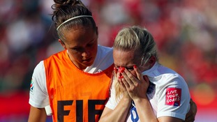 England's Laura Bassett is consoled by Jo Potter after scoring an own goal