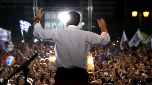 Greek Prime Minister Alexis Tsipras delivers a speech at an anti-austerity rally.
