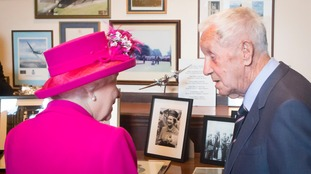 The Queen meets 94-year-old Allan Scott who she ticked off for smoking 72 years ago.