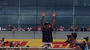 Lewis Hamilton waves to fans after his win at Silverstone.