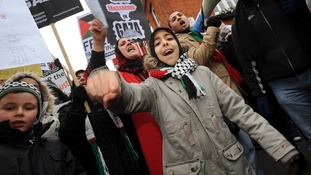 Demonstrators protest against Israel's bombing campaign in Gaza outside the Egyptian Embassy in London.