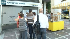 Greeks queue outside bank machines this morning