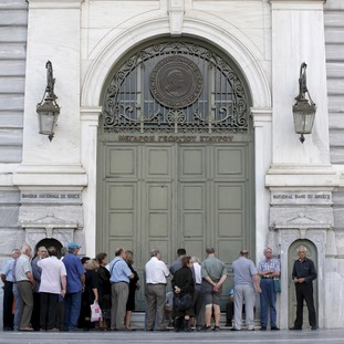 Greeks queue outside a bank in Athens today