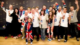 Male Gymnasts joined by family