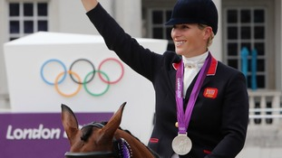 Zara Phillips celebrates with her Silver medal