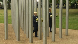 The Mayor and Prime Minister walk through the 52 pillars to mark those killed.