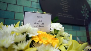 Flowers left at the July 7 memorial plaque at Aldgate Station