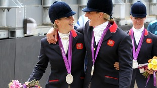 Zara Phillips and Mary King celebrate with their silver medals