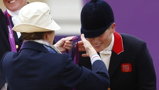 The moment Zara Phillips was presented with her silver medal by her mother the Princess Royal