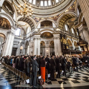 The congregation stand to observe a minute's silence during a memorial service at St Paul's Cathedral