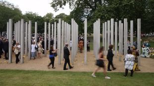 People walk through the July 7 memorial in Hyde Park,