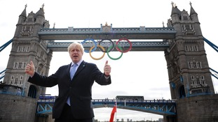 Mayor of London Boris Johnson has invited Rupert Murdoch and his wife to one of the Olympics swimming finals on Friday