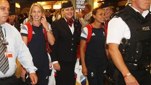 d Jessica Ennis (right) arrives at City Airport in London with other members of Team GB