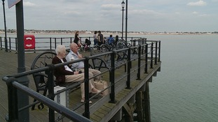 People enjoying the view at the end of the pier.