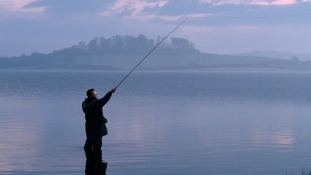 Man fishing in Rutland Water.