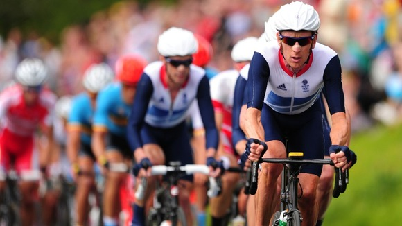 Great Britain's Bradley Wiggins leads the Peleton up Box Hill during the Men's Road race, Box Hill.